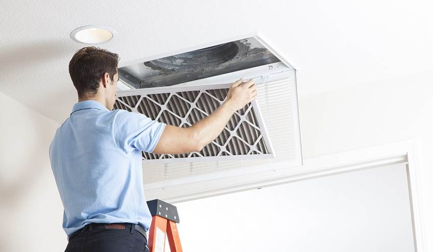 Removing an air filter from HVAC system.