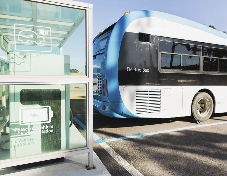 Electric bus plugged into a charging station